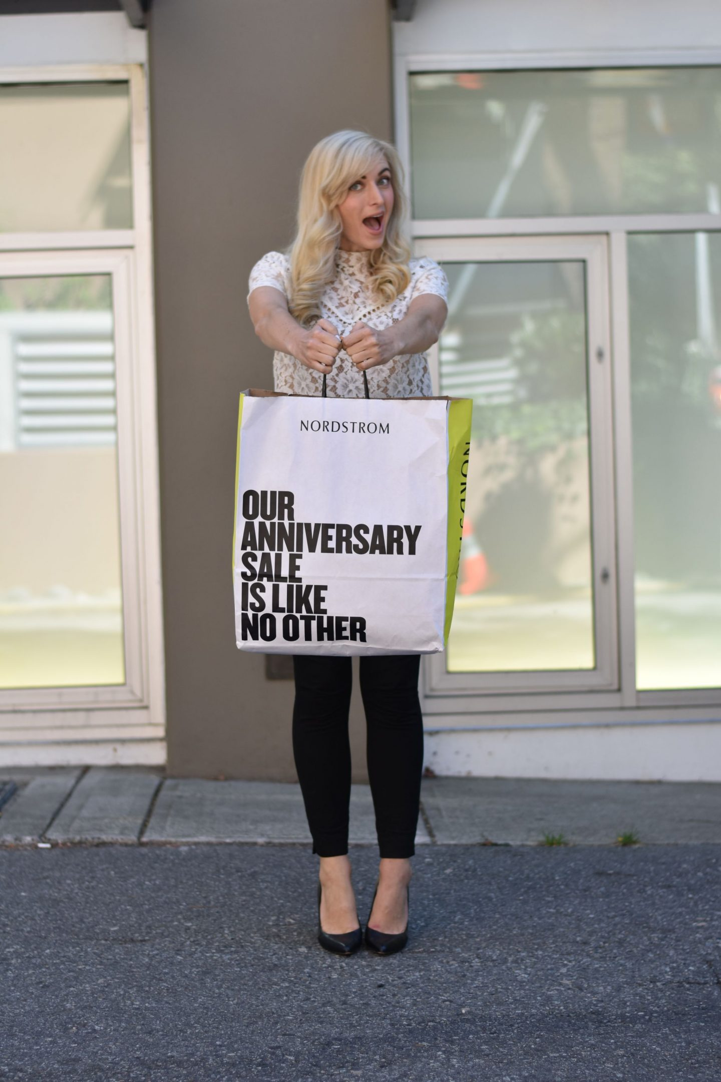 how to shop the nordstrom anniversary sale if you're in canada - woman holding nordstrom anniversary sale bag