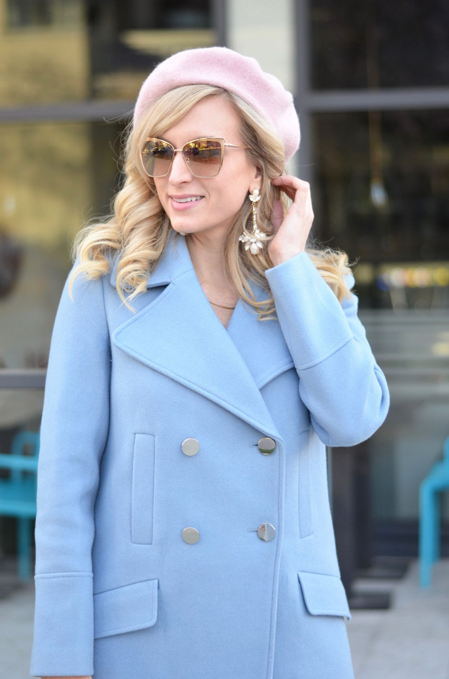 pastel blue coat with a pink beret spring fashion trend