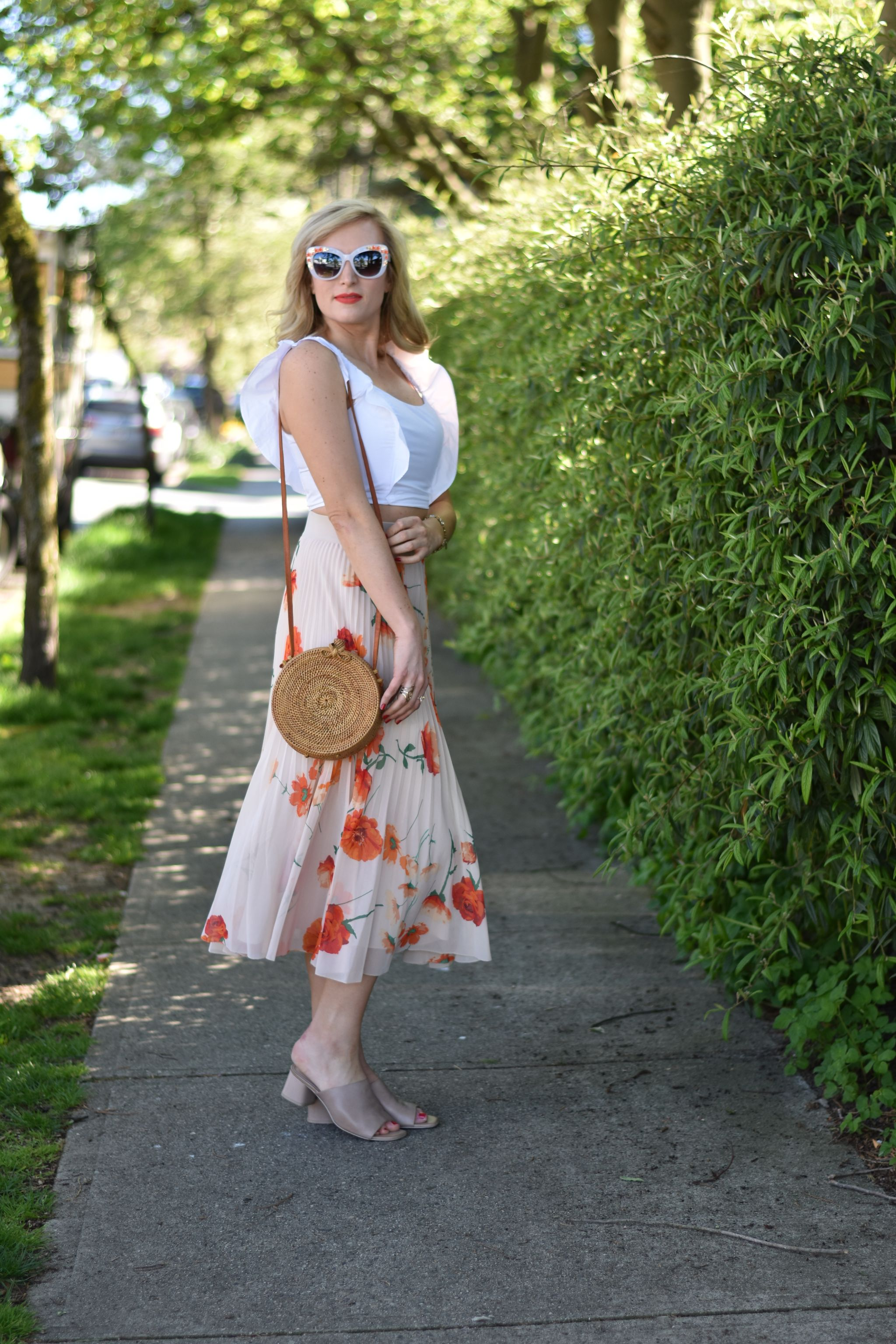 spring outfit idea floral pleated midi and crop top