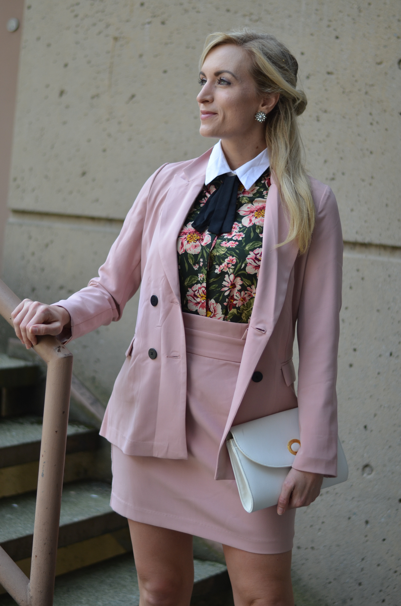 blonde woman wearing blush pink skirt suit