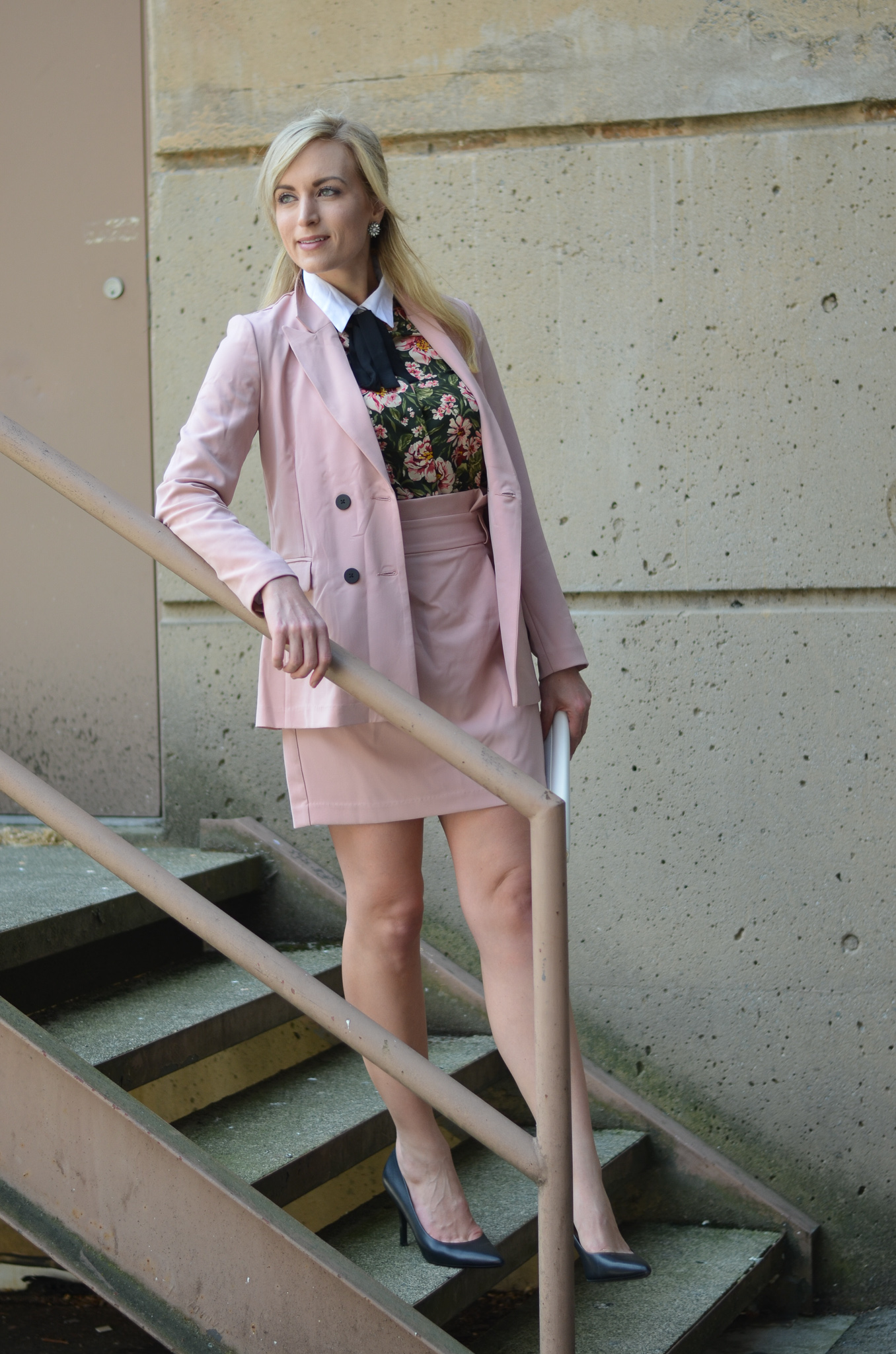 woman wearing blush pink women's suit
