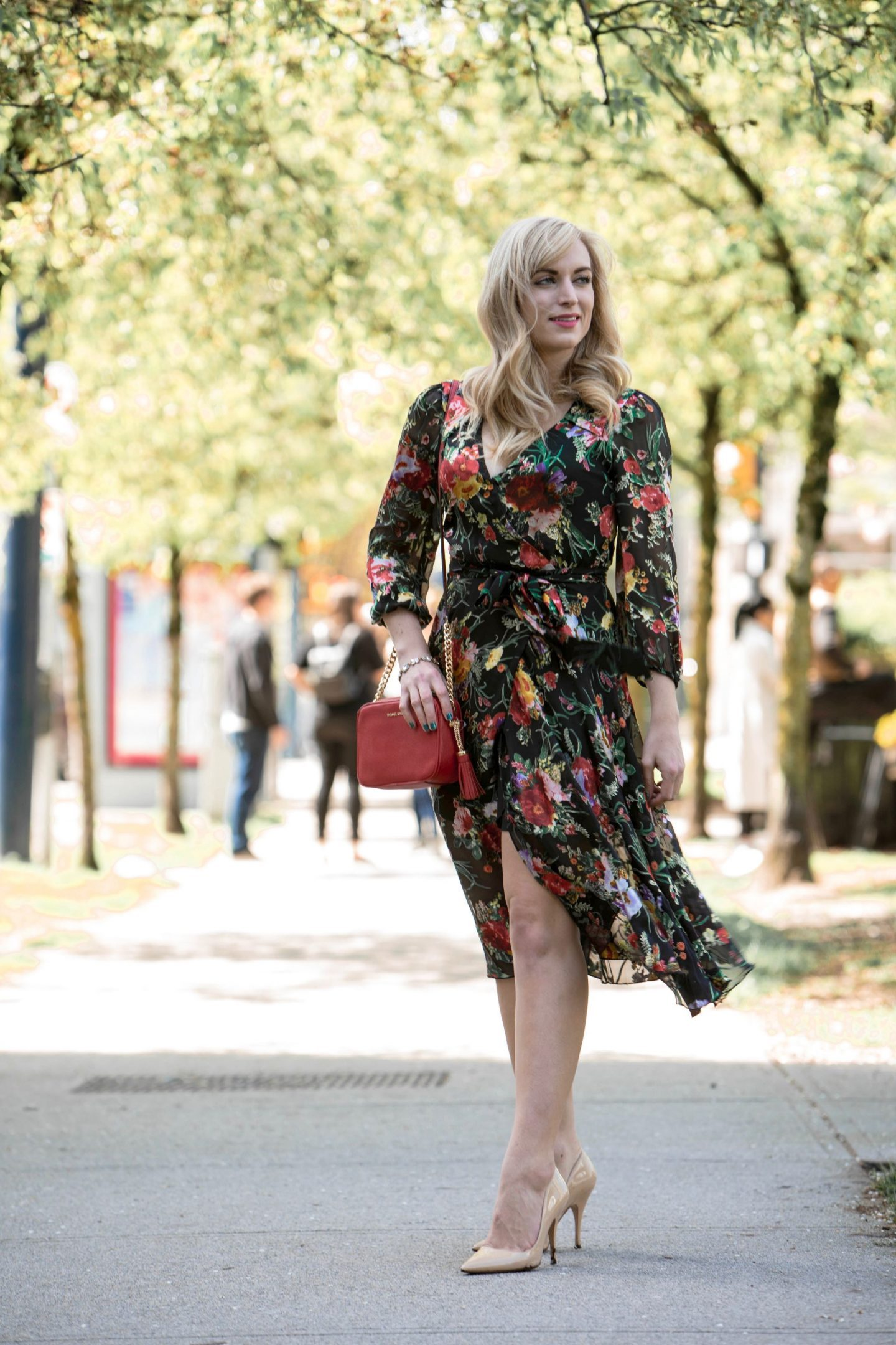 outfit printed wrap dress with high heels and red handbag best memorial day sales