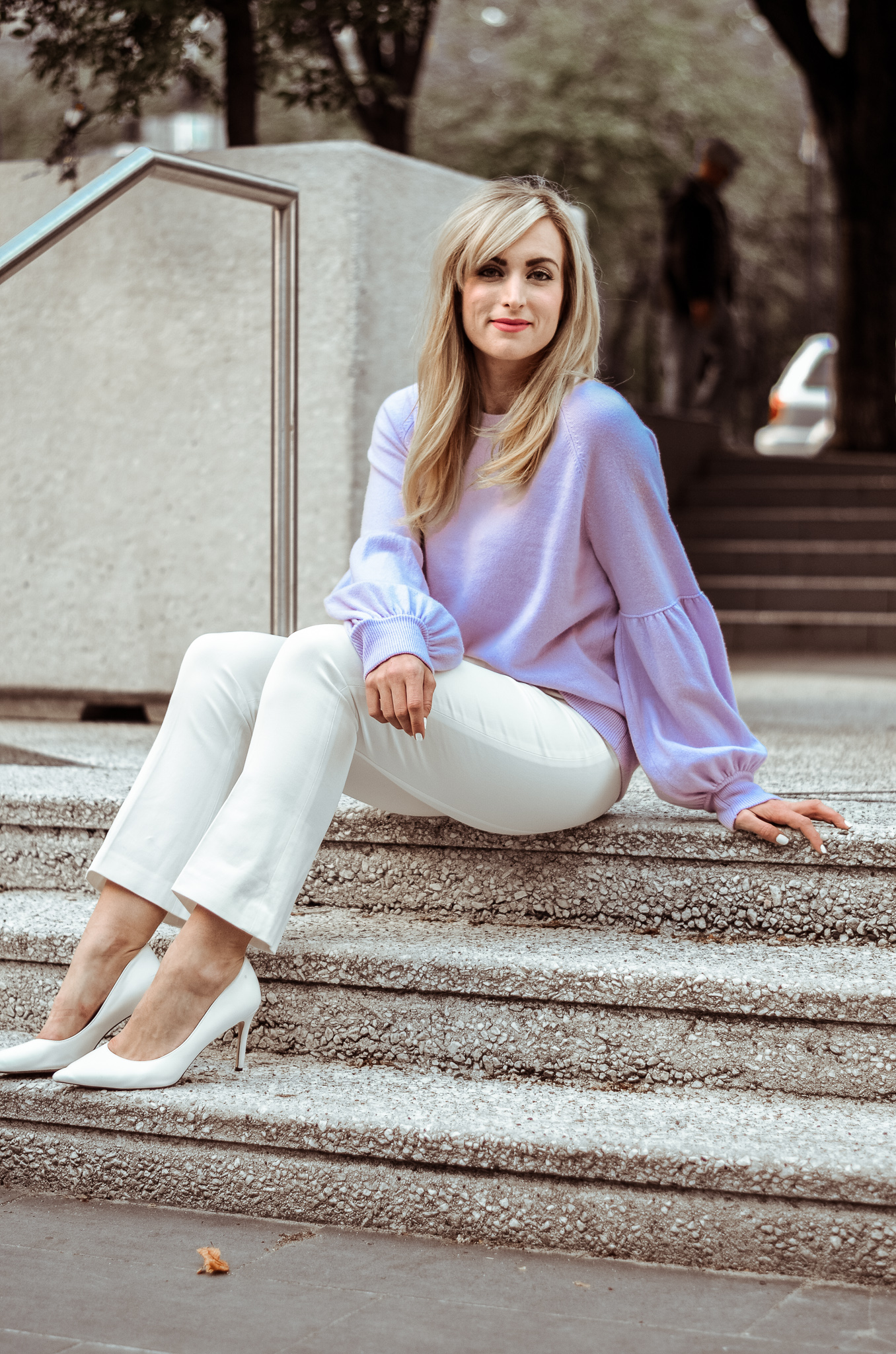 what to wear to a freezing office in the summer legallee blonde blogger sitting on stairs in lilac sweater and white capri pants