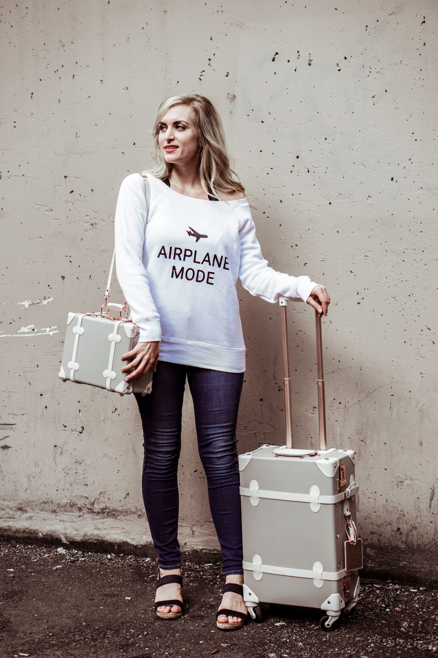 airplane mode sweater and dove grey vintage luggage