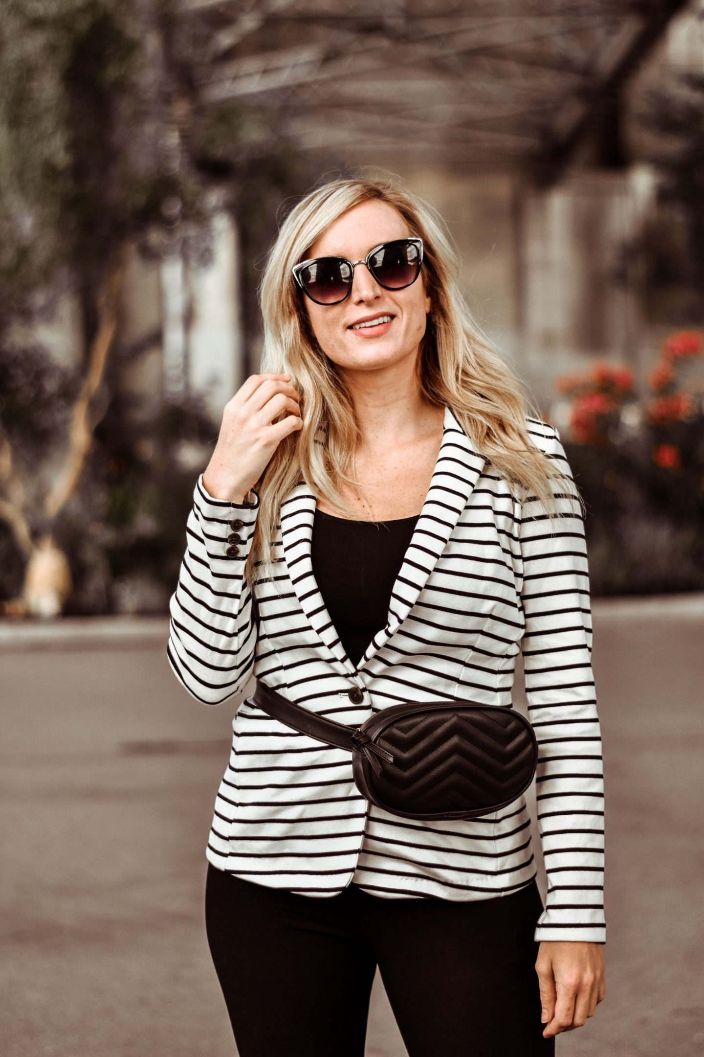 black and white striped blazer with a quilted black fanny pack