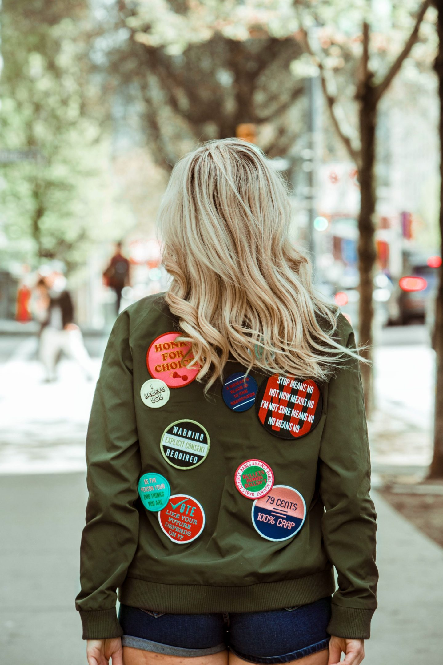intersectional feminism blonde wearing wildfang feminist patch jacket