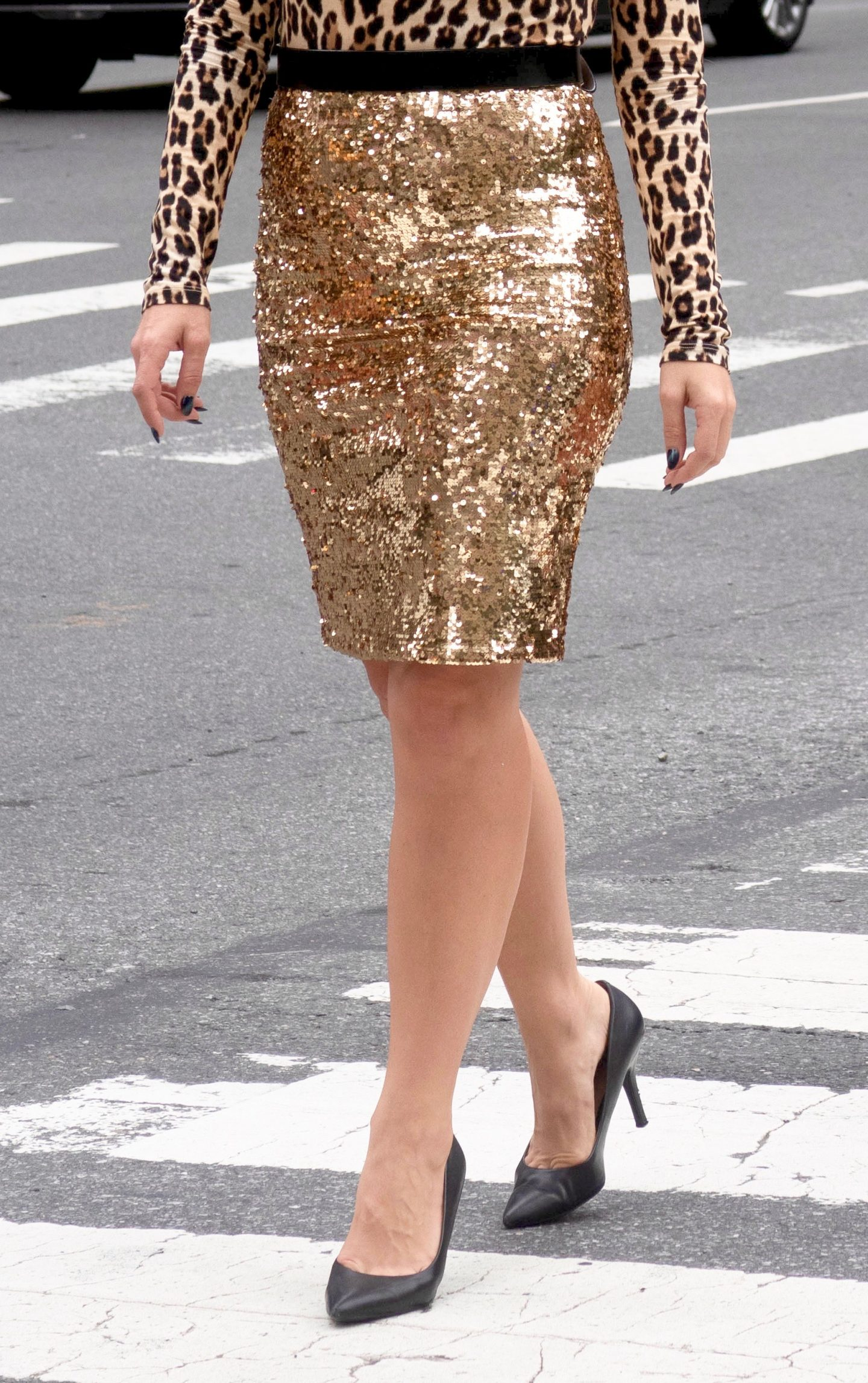 legallee blonde wearing gold sequin pencil skirt