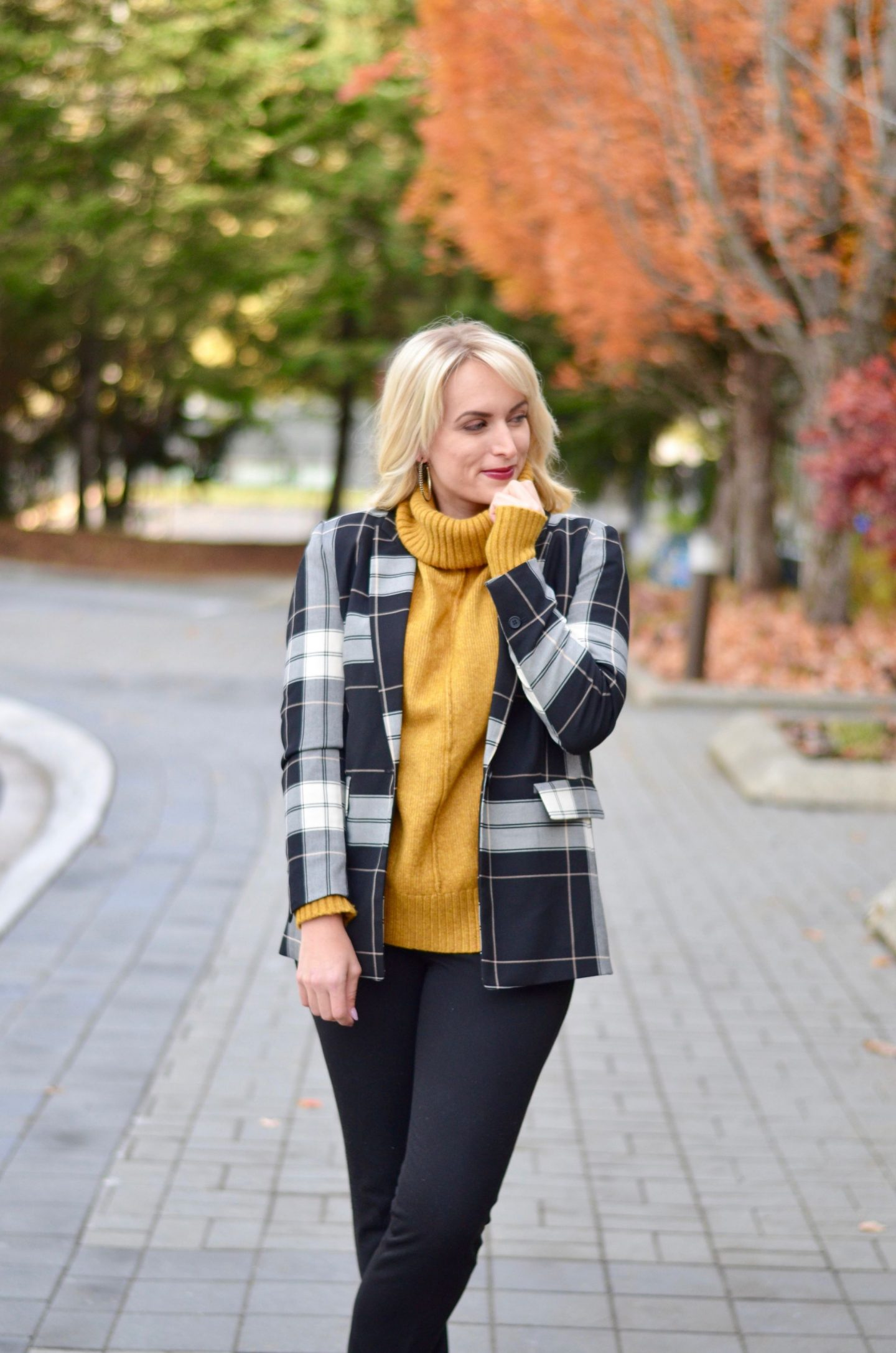 how to layer for work fall outfit mustard yellow turtleneck under plaid blazer