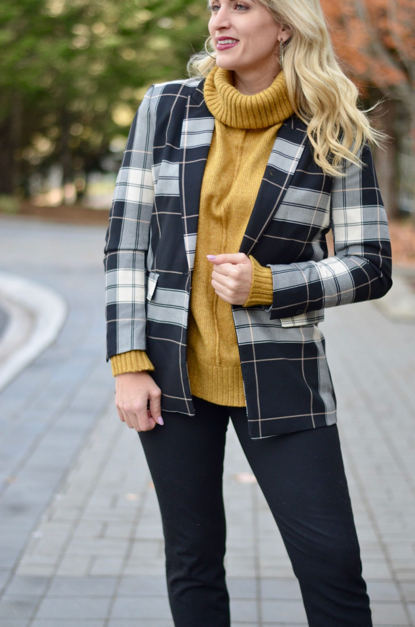 mustard yellow turtleneck and plaid blazer