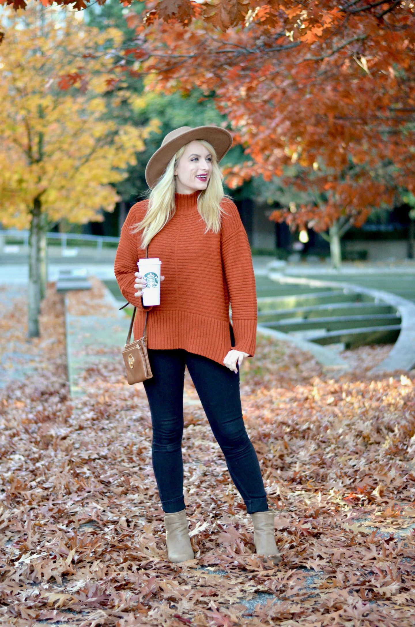 fall outfit idea burnt orange sweater and jeans