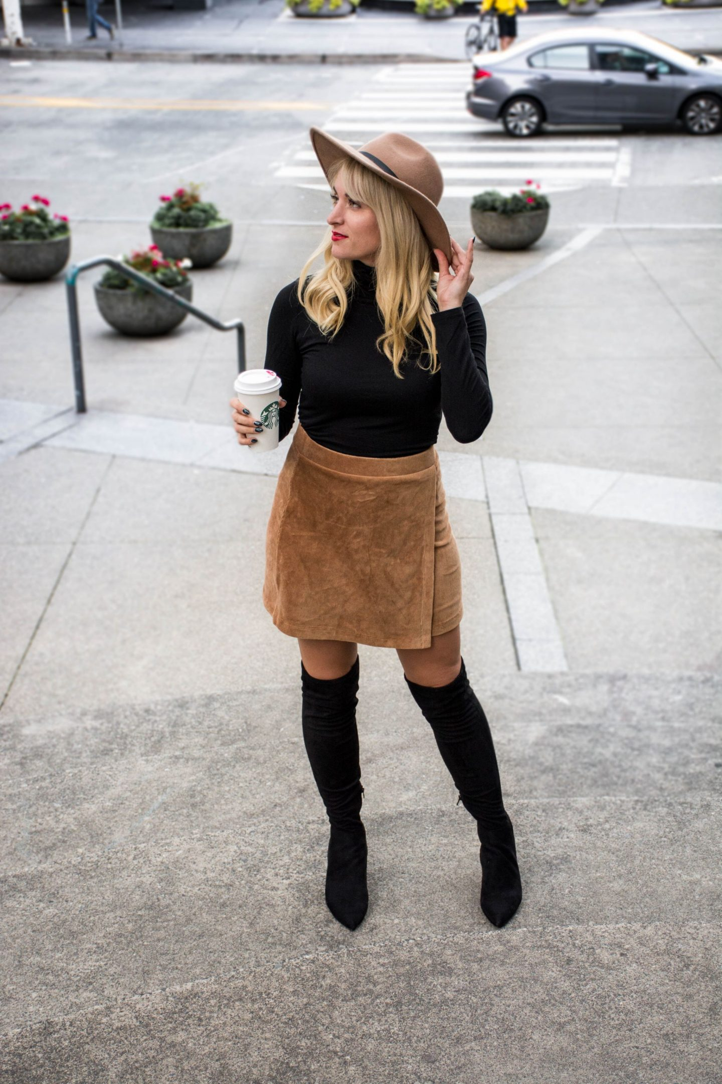 fashion blogger wearing corduroy mini skirt camel and over the knee boots