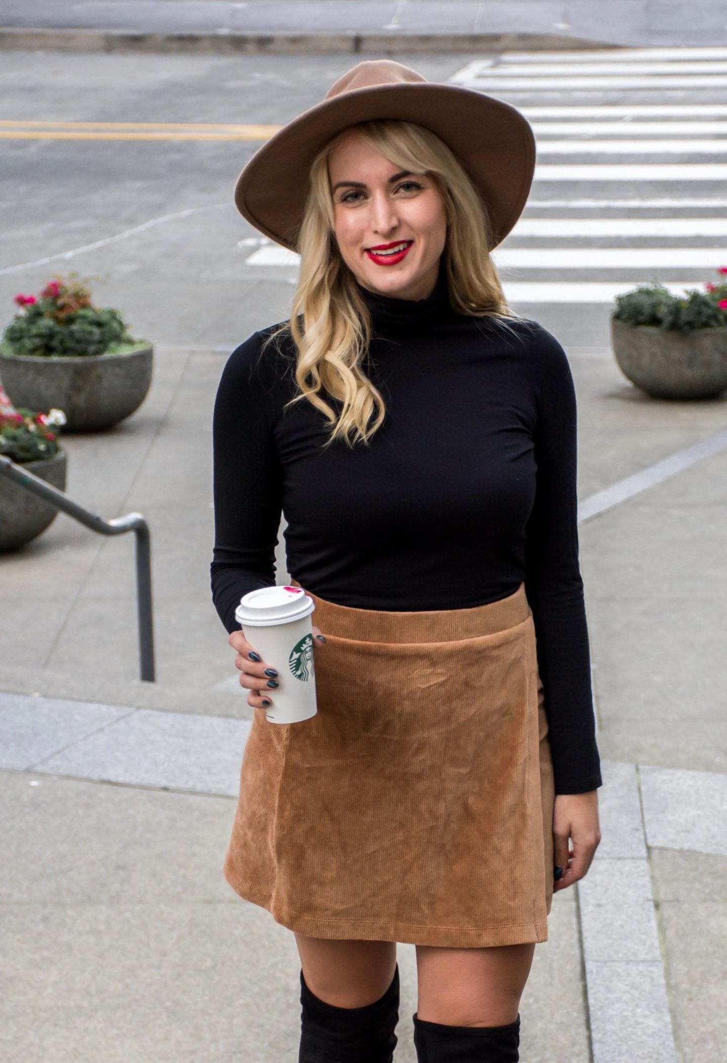 legalleeblonde wearing corduroy mini skirt black turtleneck and hat