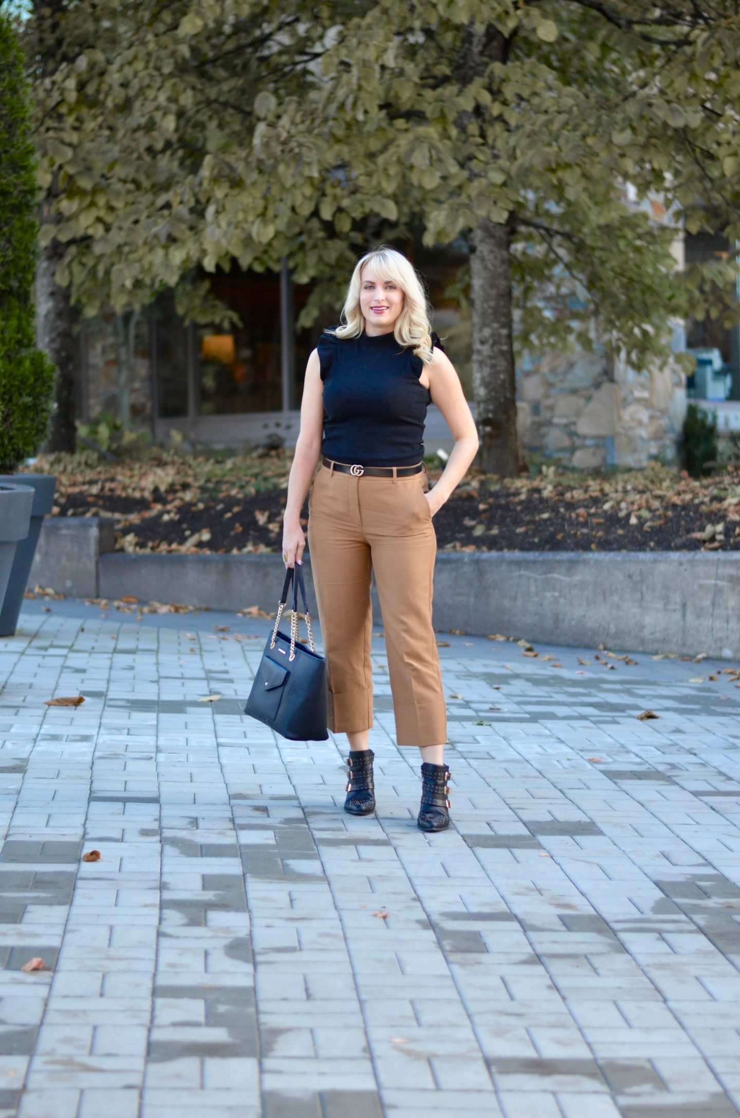 camel culottes and black mock neck top