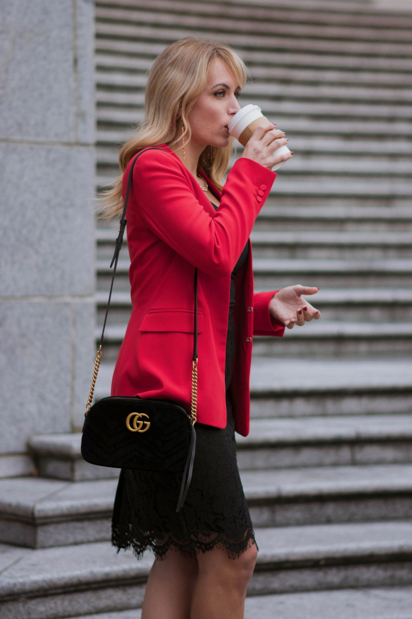 one-blonde-woman-drinking-coffee-red-blazer-black-skirt-what-to-wear-with-a-red-blazer