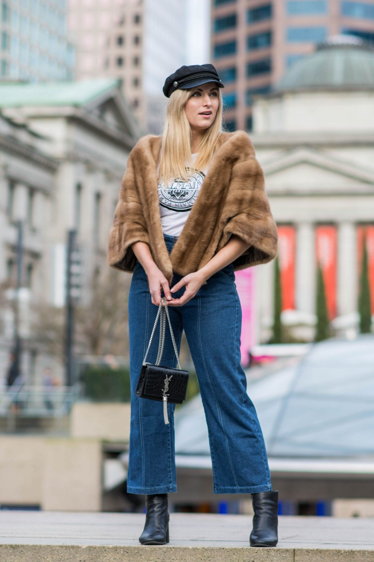 legallee-blonde-wearing-denim-culottes-fur-stole-YSL-handbag