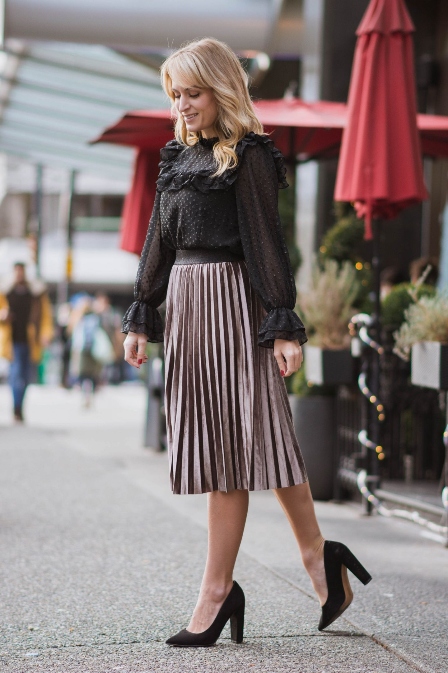 woman-wearing-pleated-velvet-midi-skirt-outfit-walking