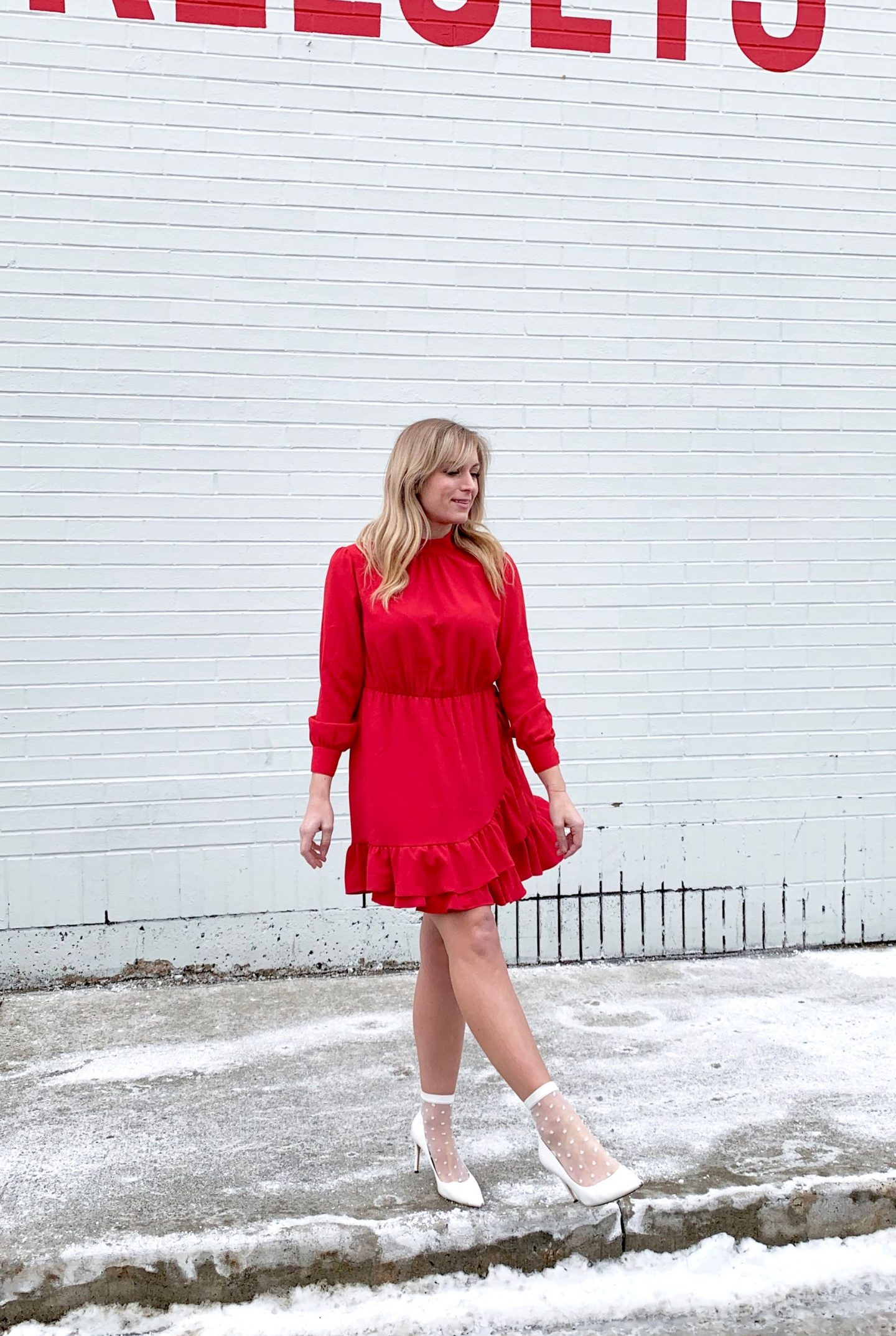 woman-wearing-red-long-sleeve-dress-white-heels-valentine's-day-outfit-idea