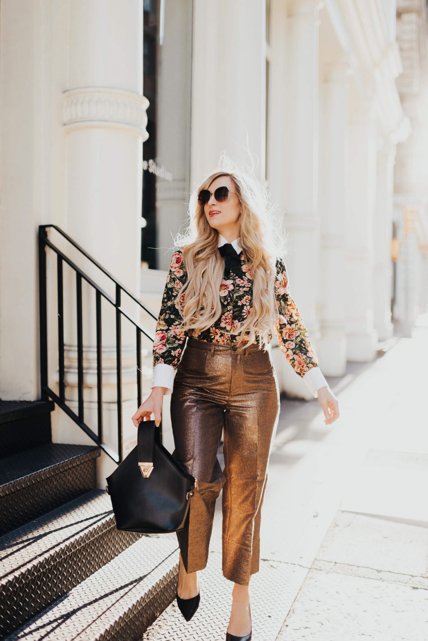 woman wearing floral top and bronze metallic culottes walking in new york