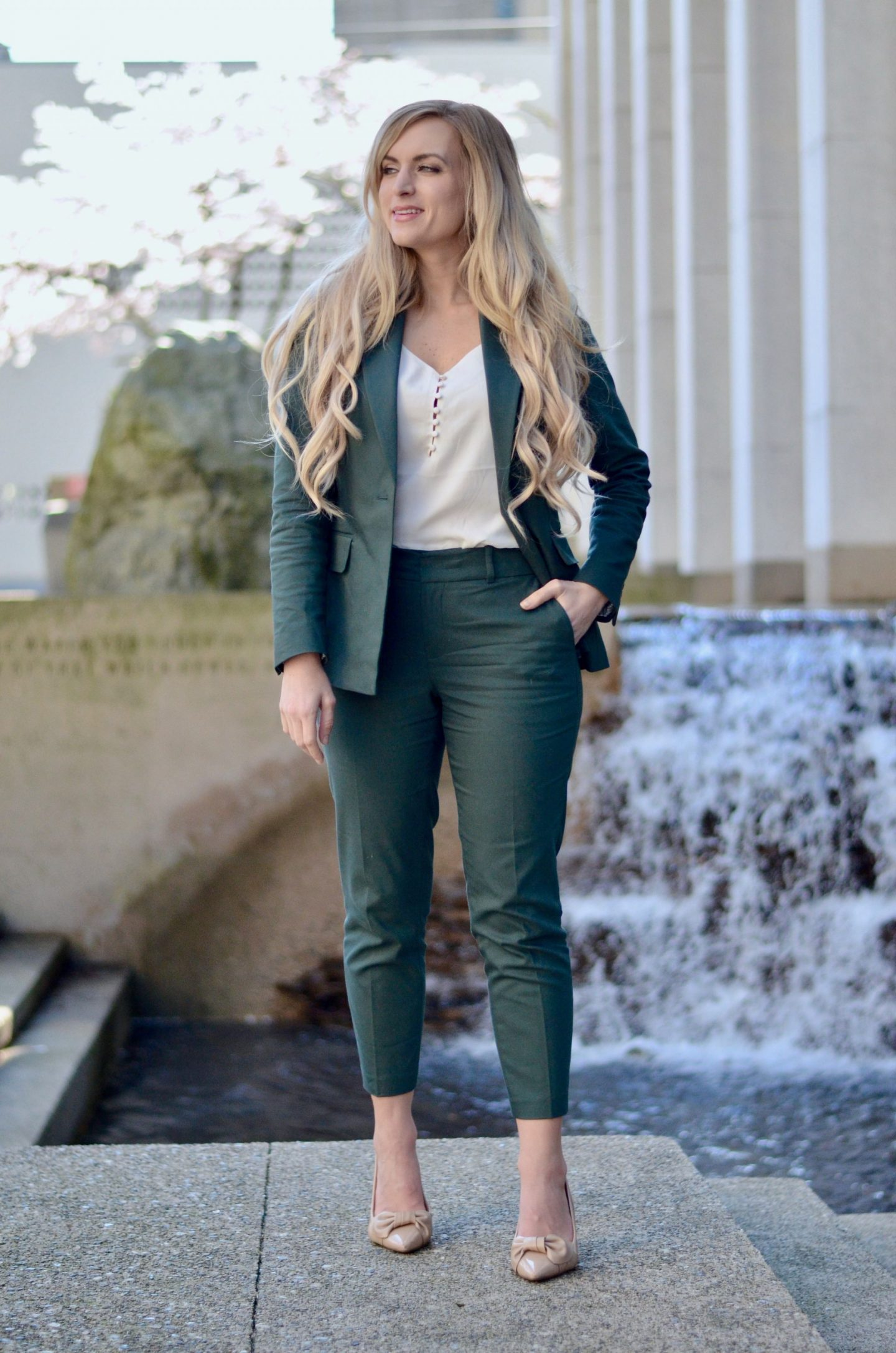blonde woman wearing what to wear to work this spring forest green pant suit