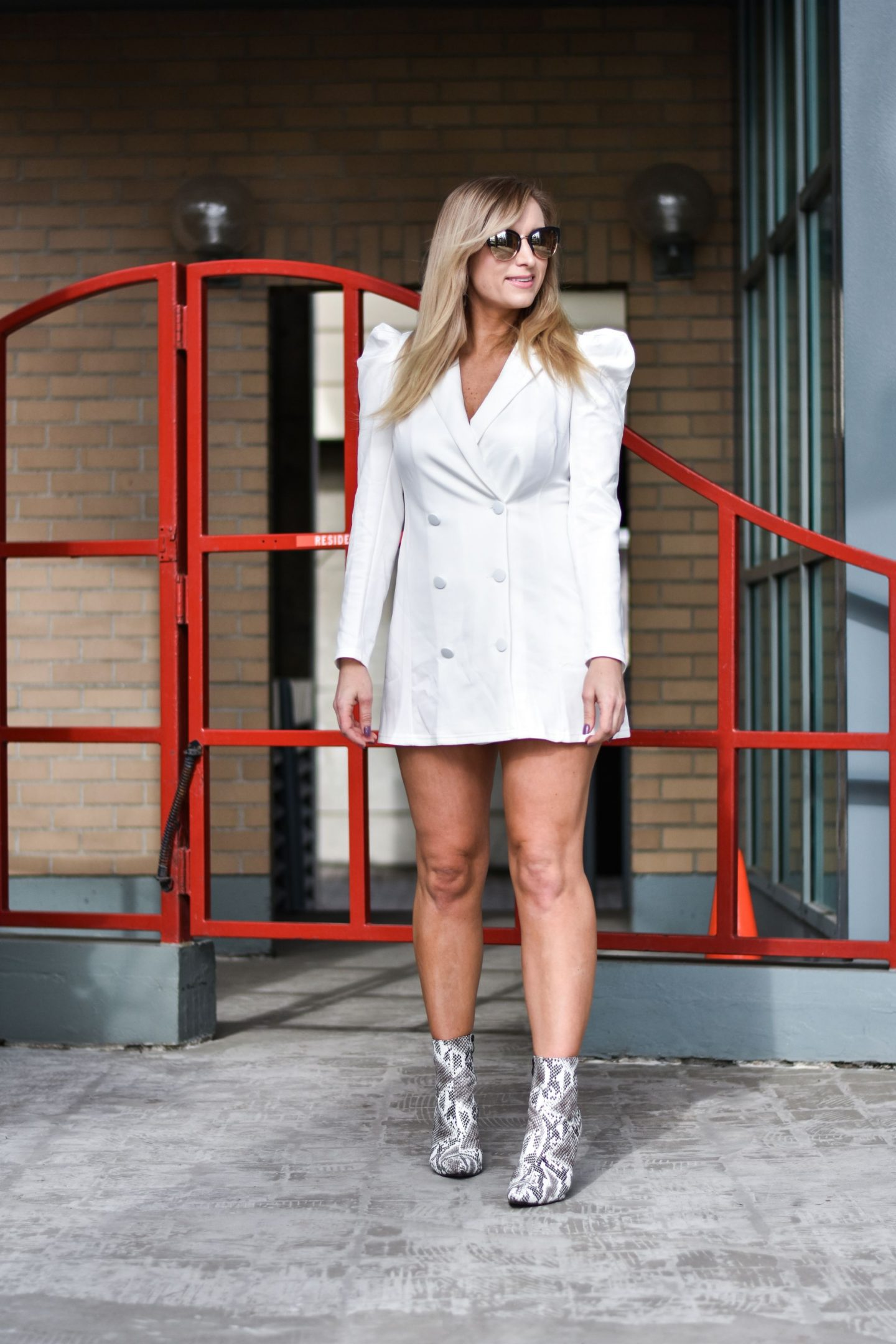 blonde-wearing-white-dress-ankle-boots-What-to-Wear-with-Snakeskin-Boots