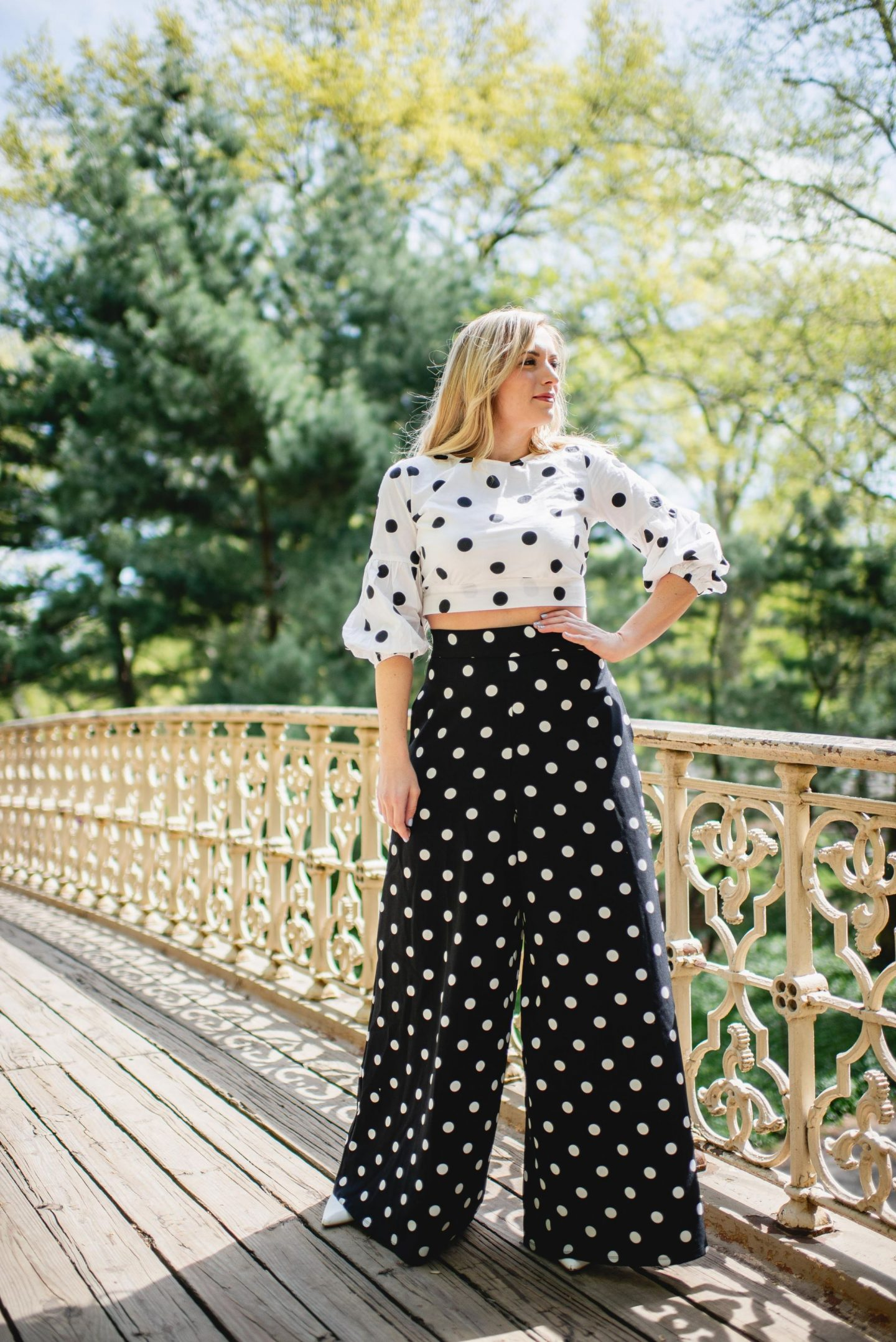 blonde wearing polka dot crop top and wide leg polka dot pants - outfit idea to show how to styke polka dots for spring/summer 2019