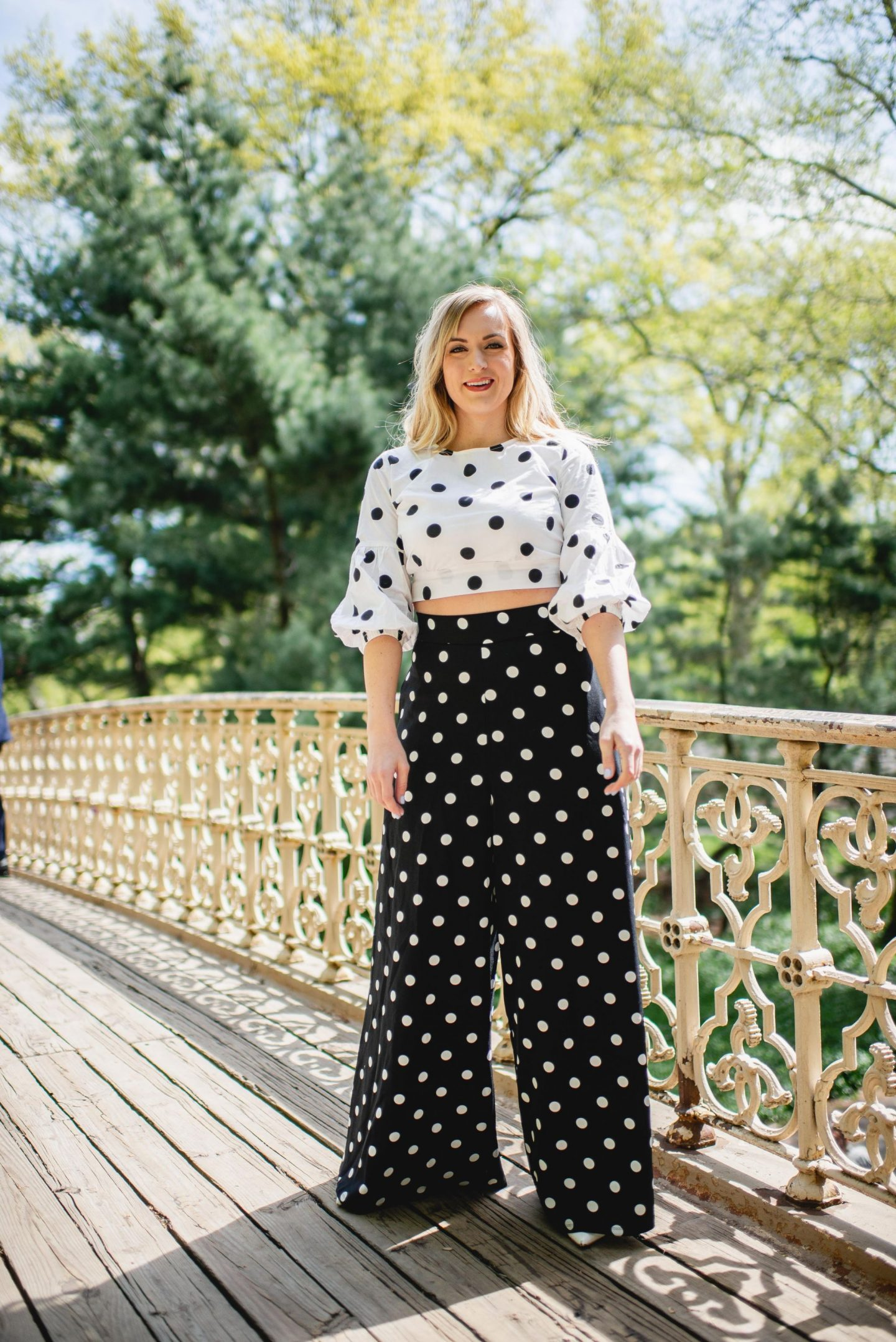 one blonde woman wearing polka dot outfit for post on how to style polka dots for spring/summer 2019