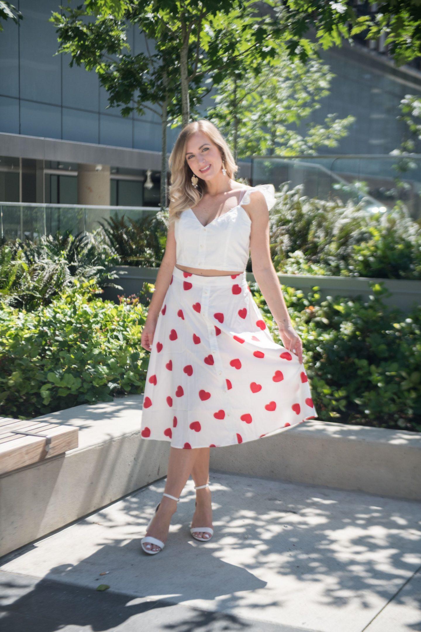 woman wearing heart print midi skirt and crop top