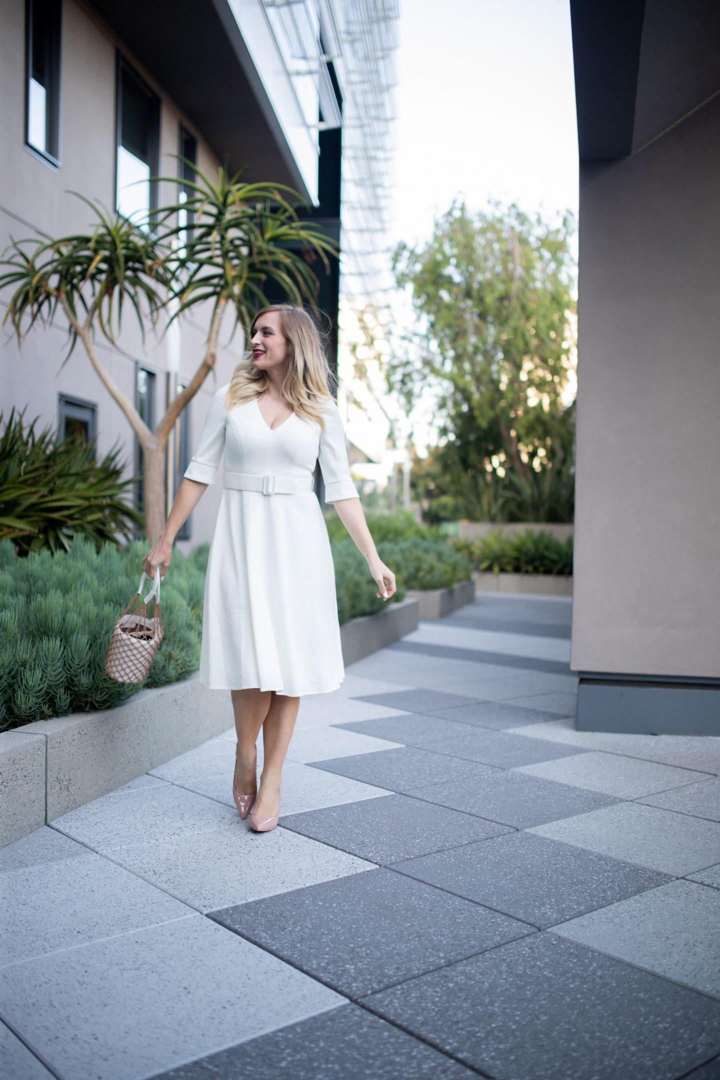 woman-wearing-harper-rose-white-dress