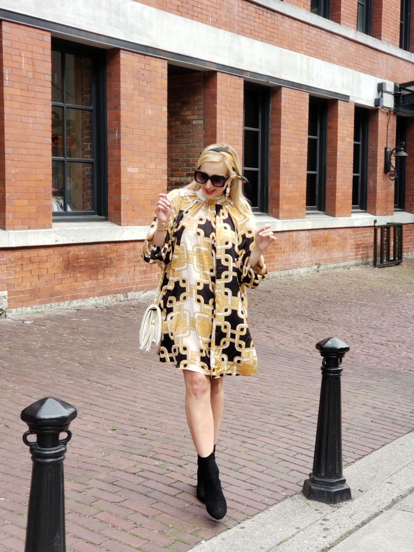 richard allan x h&m collection woman wearing shift dress