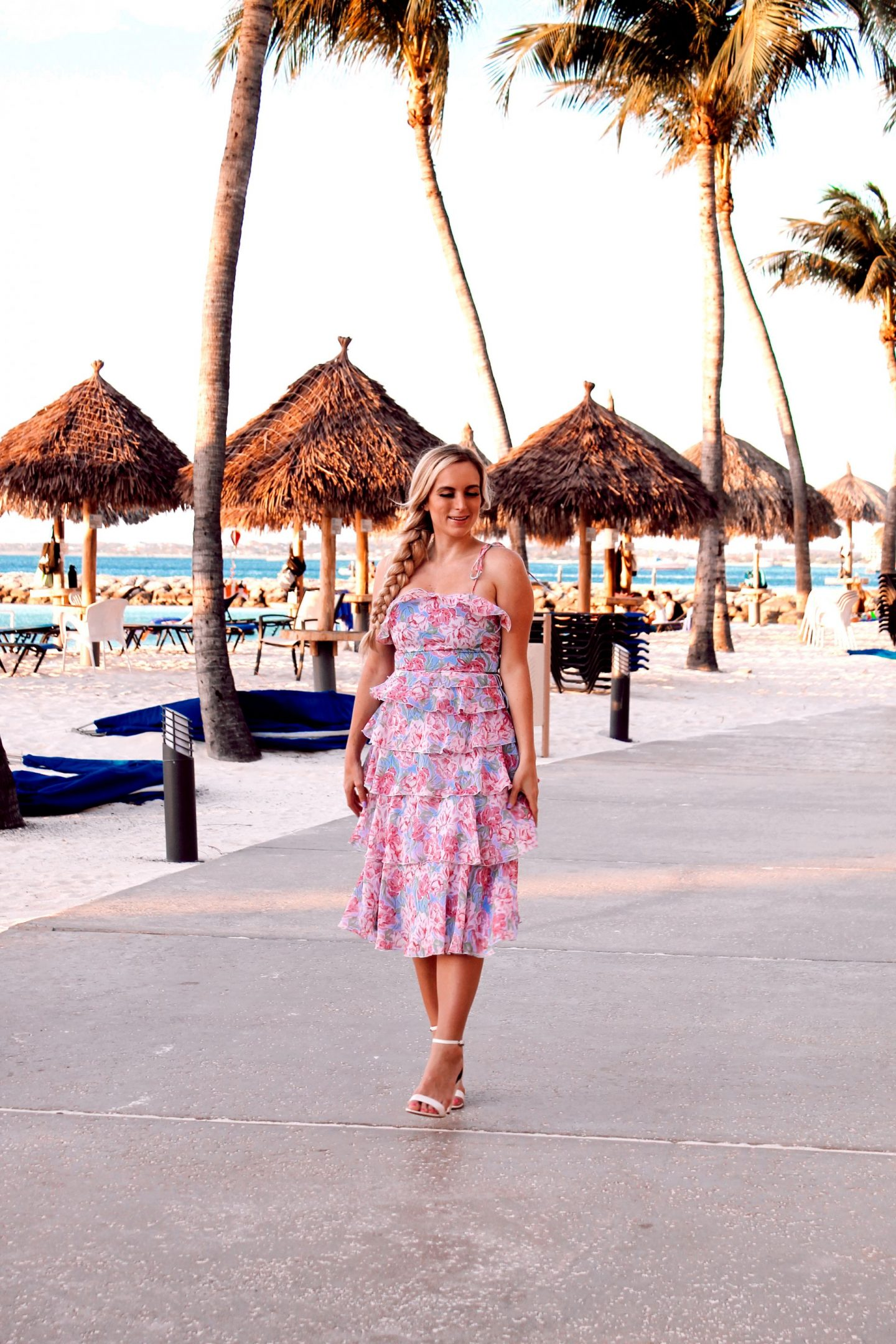 one woman standing wearing a summery dress for your winter getaway