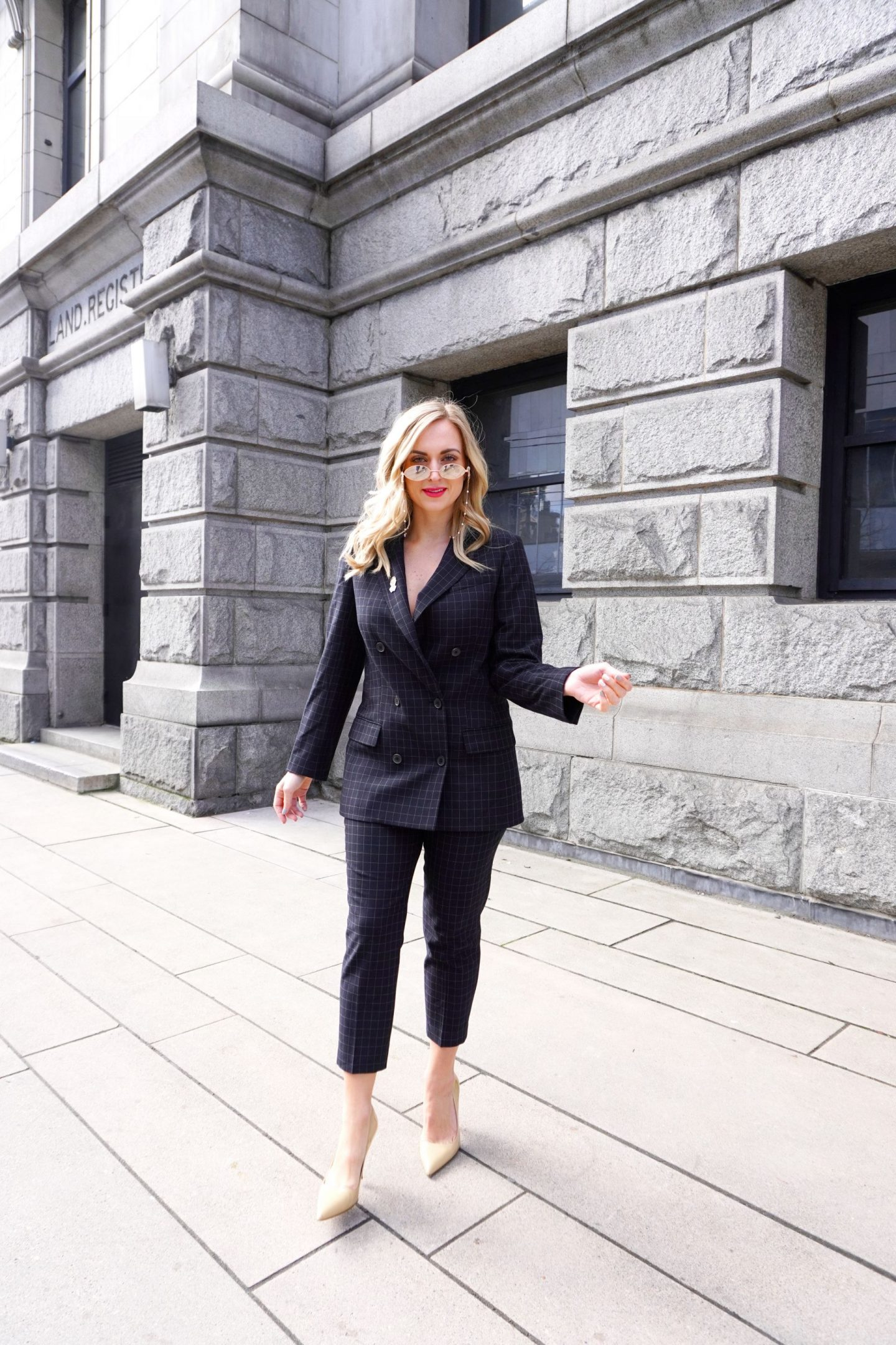 woman wearing pantsuit inspired by Andrea D. Lyon
