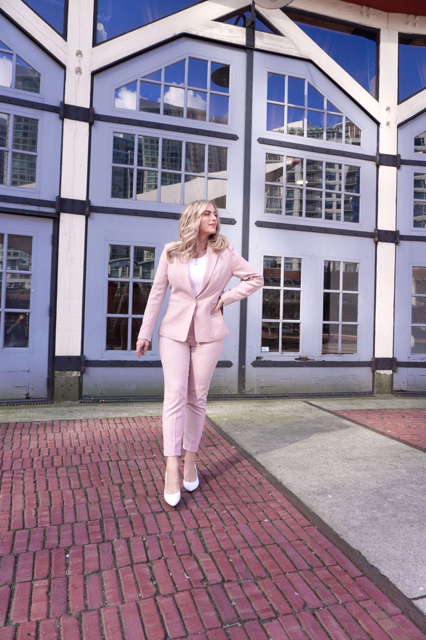 woman wearing pink pantsuit inspired by: nancy pelosi