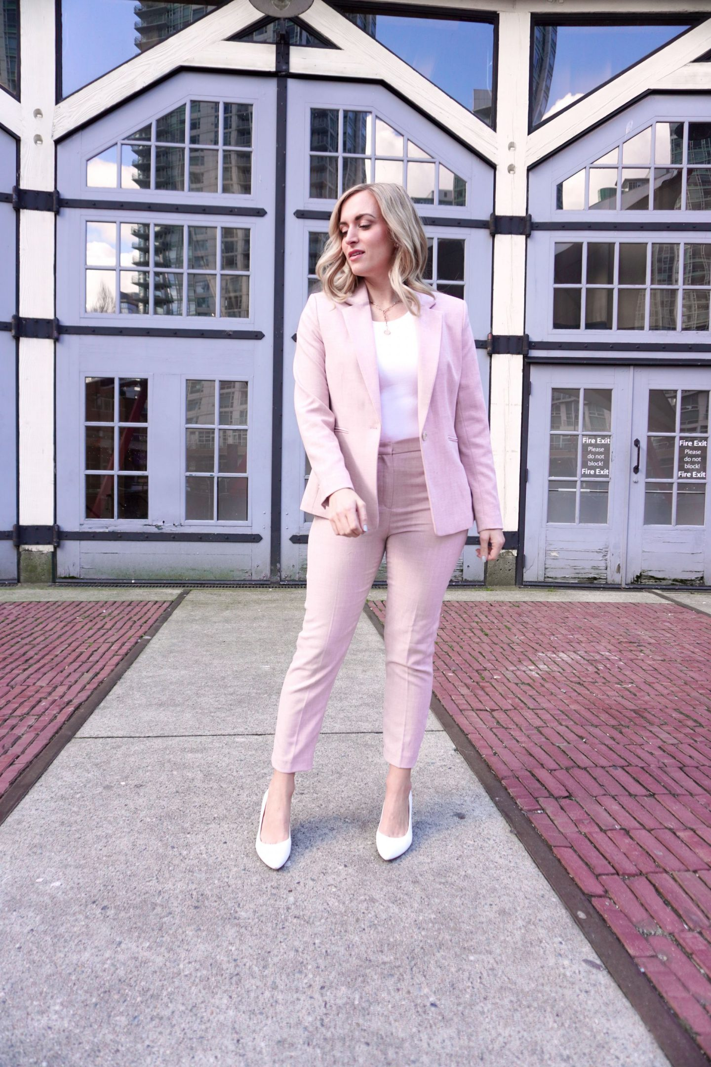 woman wearing pink pantsuit inspired by nancy pelosi