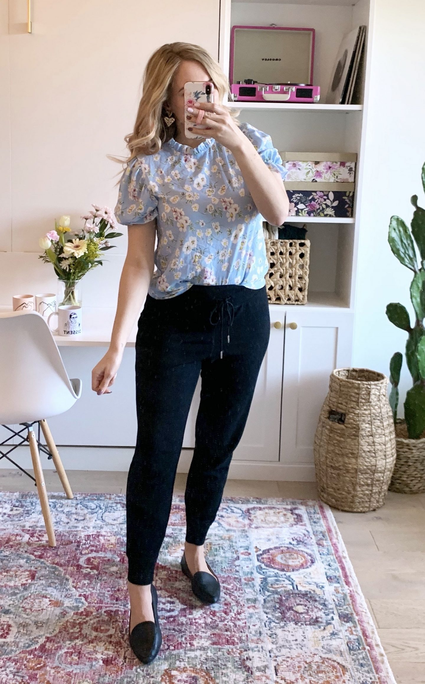 woman wearing joggers and a spring blouse work from home outfit ideas