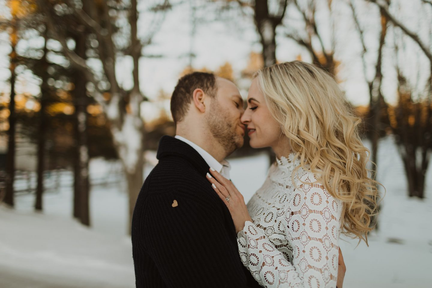 winter engagement photo man & woman kissing LegalLeeBlonde