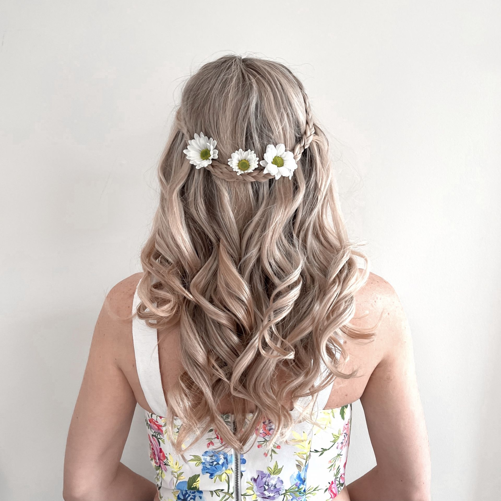 spring hairstyles for long hair curled hair with a braid and flowers
