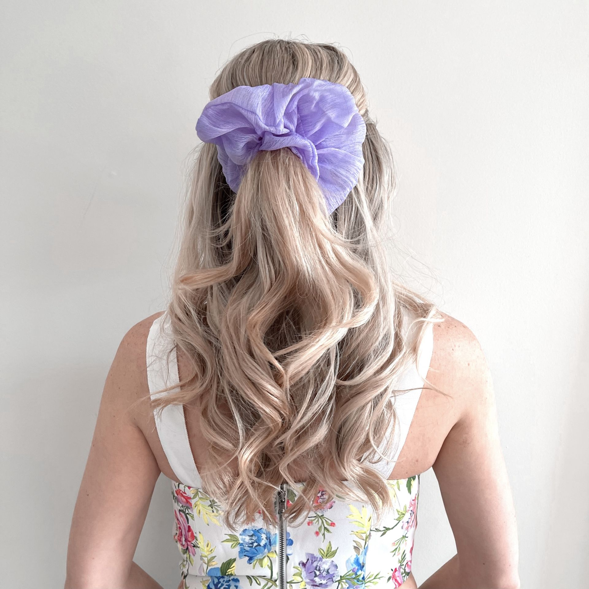 half up hairstyle with scrunchie spring hairstyles for long hair