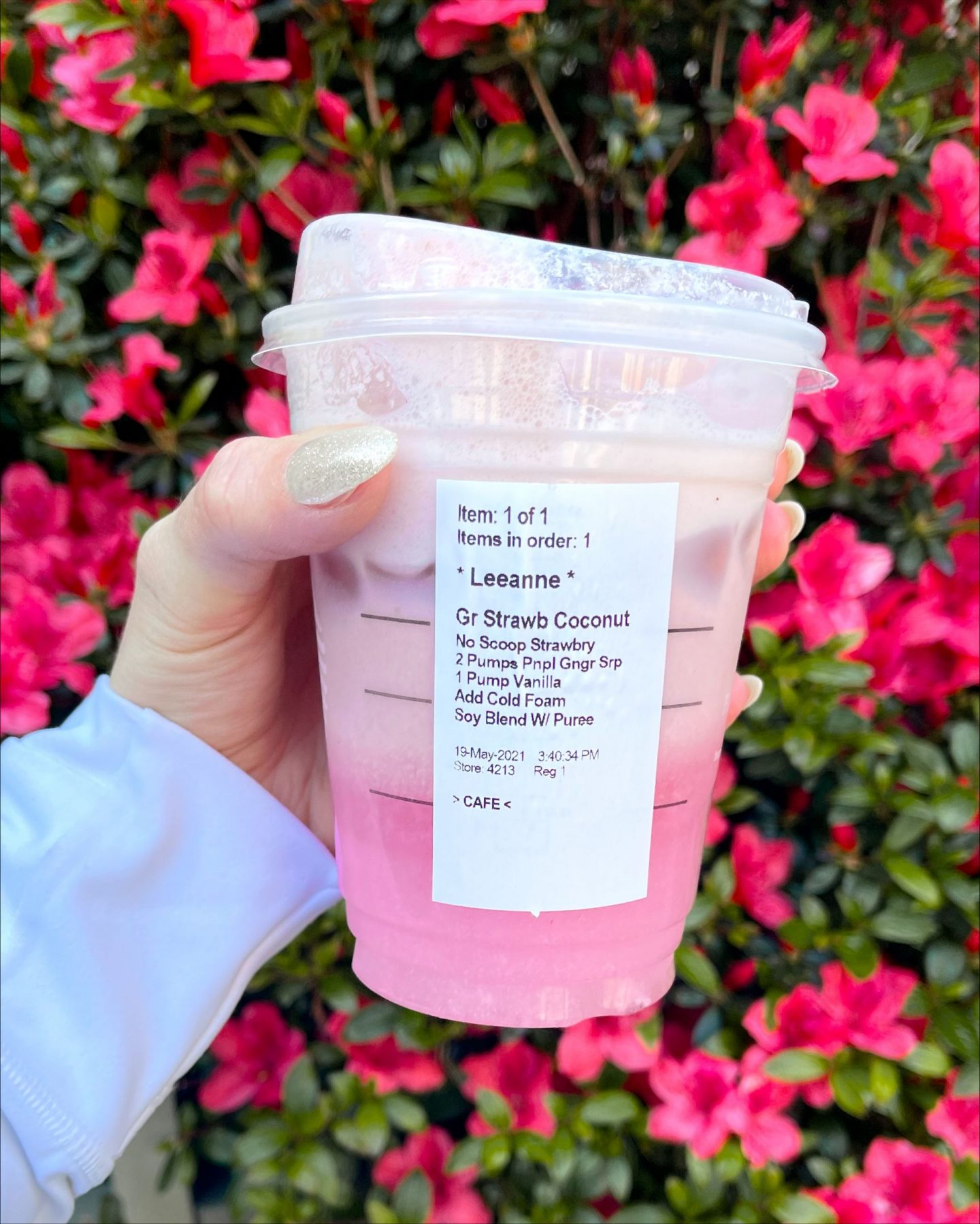 hand holding starbucks cup with a starbucks secret menu drink for summer