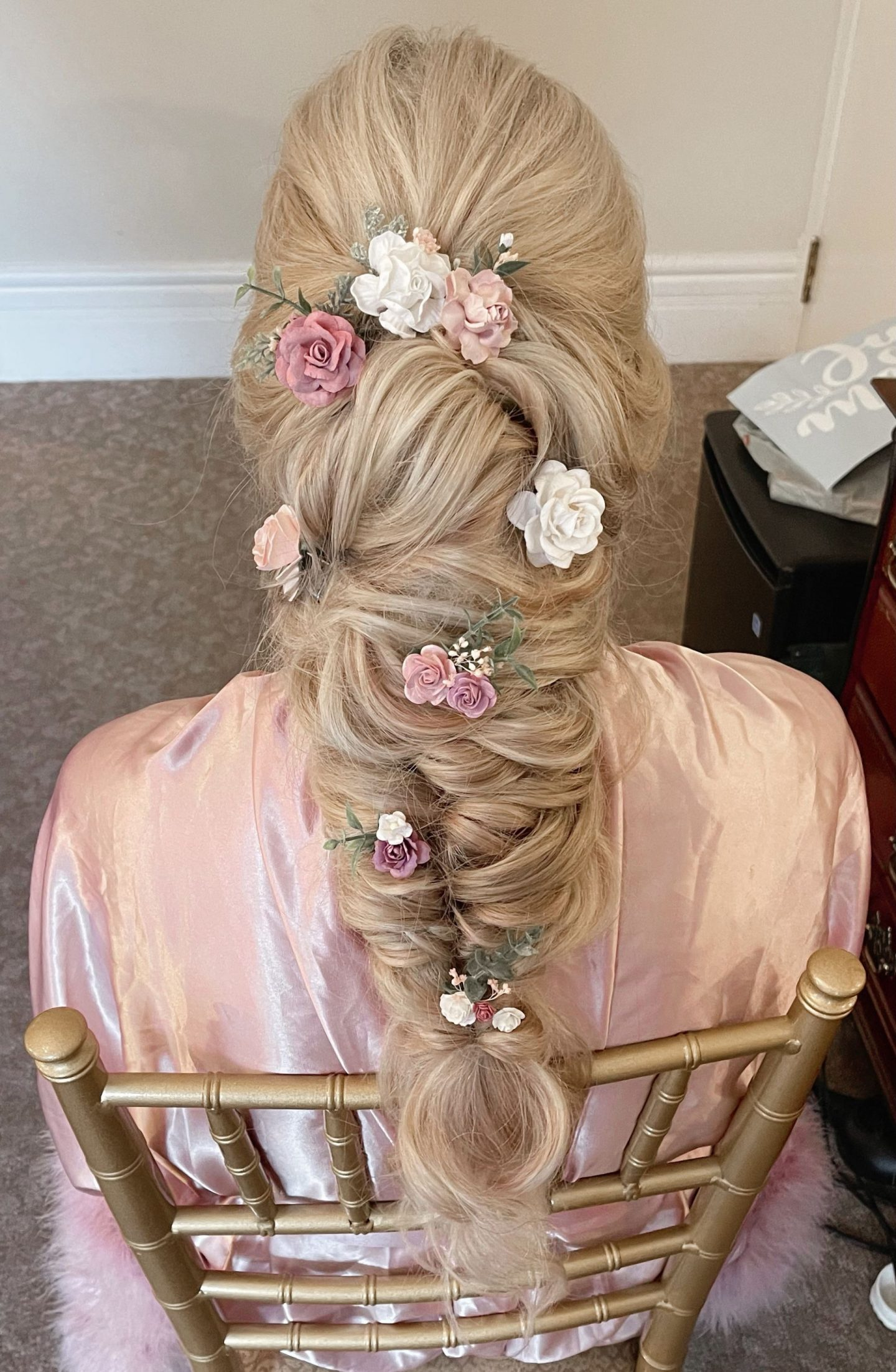 bohowedding day hairstyle loose braid with flower pins
