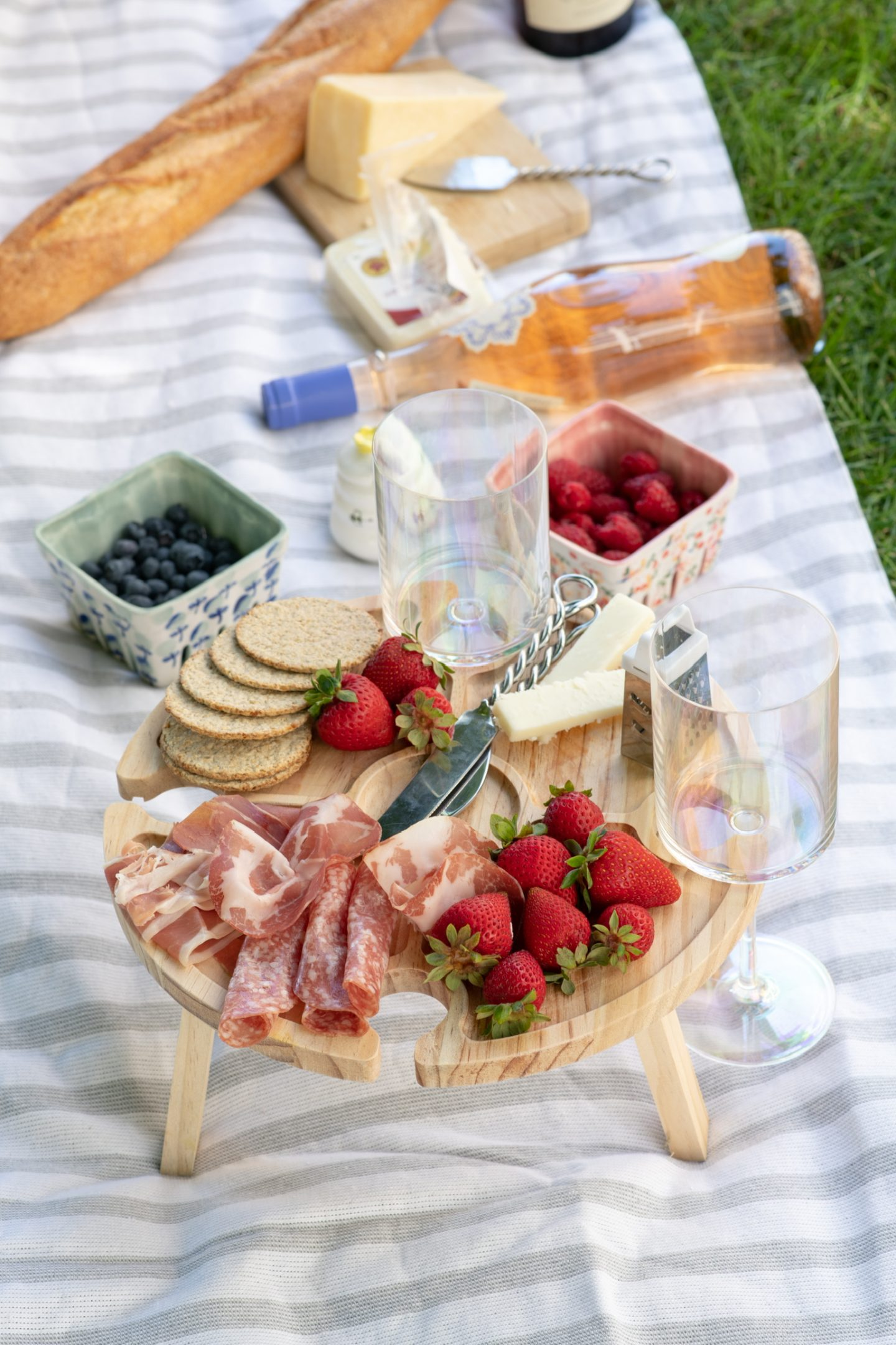 late summer picnic set up - foldable table, simple menu and picnic accessories